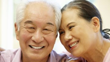 Senior Asian couple at home