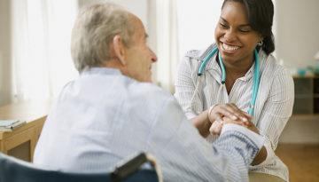 Nurse and elderly man spending time together