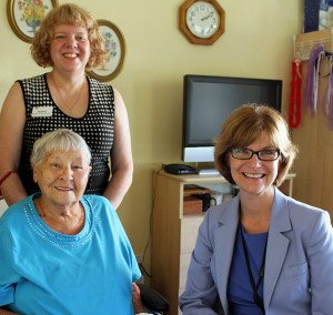 Seniors Advocate Isobel Mackenzie meets with Sunridge Place resident Lorna Taylor (left) and director of care Debbie Easson (standing).