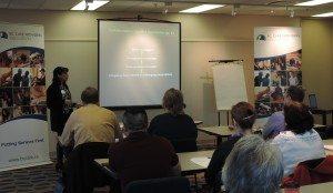 Workshop leader Raj Dhasi explains collaborative conflict resolution strategies for care teams
