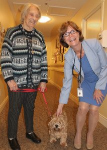 Provincial Seniors Advocate Isobel Mackenzie (right) makes a connection with Toby, accompanied by owner and Sunridge resident Christina Radcliffe (left) during a visit to Sunridge Place in Duncan on Friday, July 11.