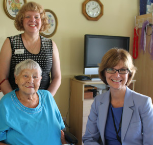 Provincial Seniors Advocate Isobel Mackenzie (left) connects with Sunridge resident Lorna Taylor (right) and Director of Care Debbie Easson (standing) during a visit to Sunridge Place in Duncan on Friday, July 11.