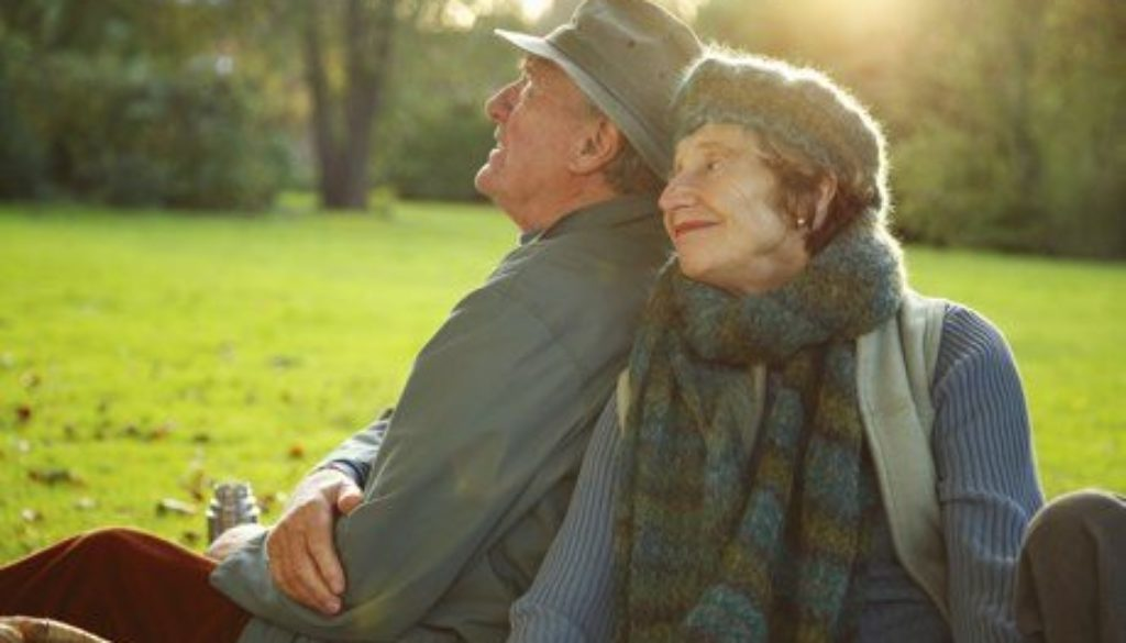 Older couple sitting in a garden