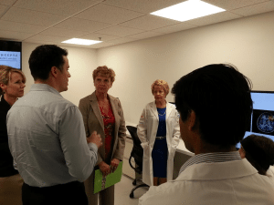 Hon. Linda Larson learns about RC's leading edge research from renowned neuroscientist, Dr. Ryan Darcy, explains neurological
