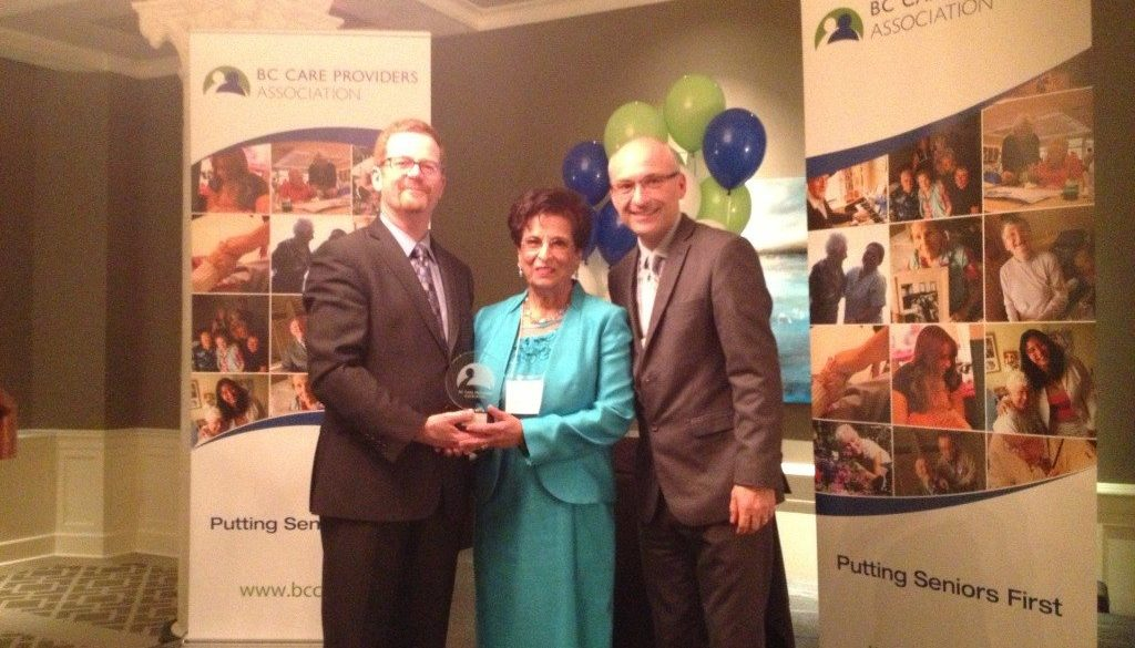 Jane Devji receiving one of three awards at the 2014 BC Care Awards