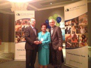 Jane Devji receives the Ed Helfrich Long Service award after more than 40 years of devotion