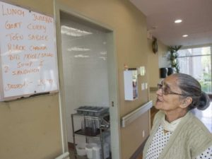 Resident Sroj Sood peruses the day's lunch menu at the Guru Nanak Niwas senior home in Surrey.
